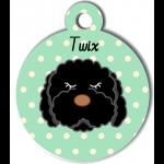 Médaille vert chien frisé noir type caniche